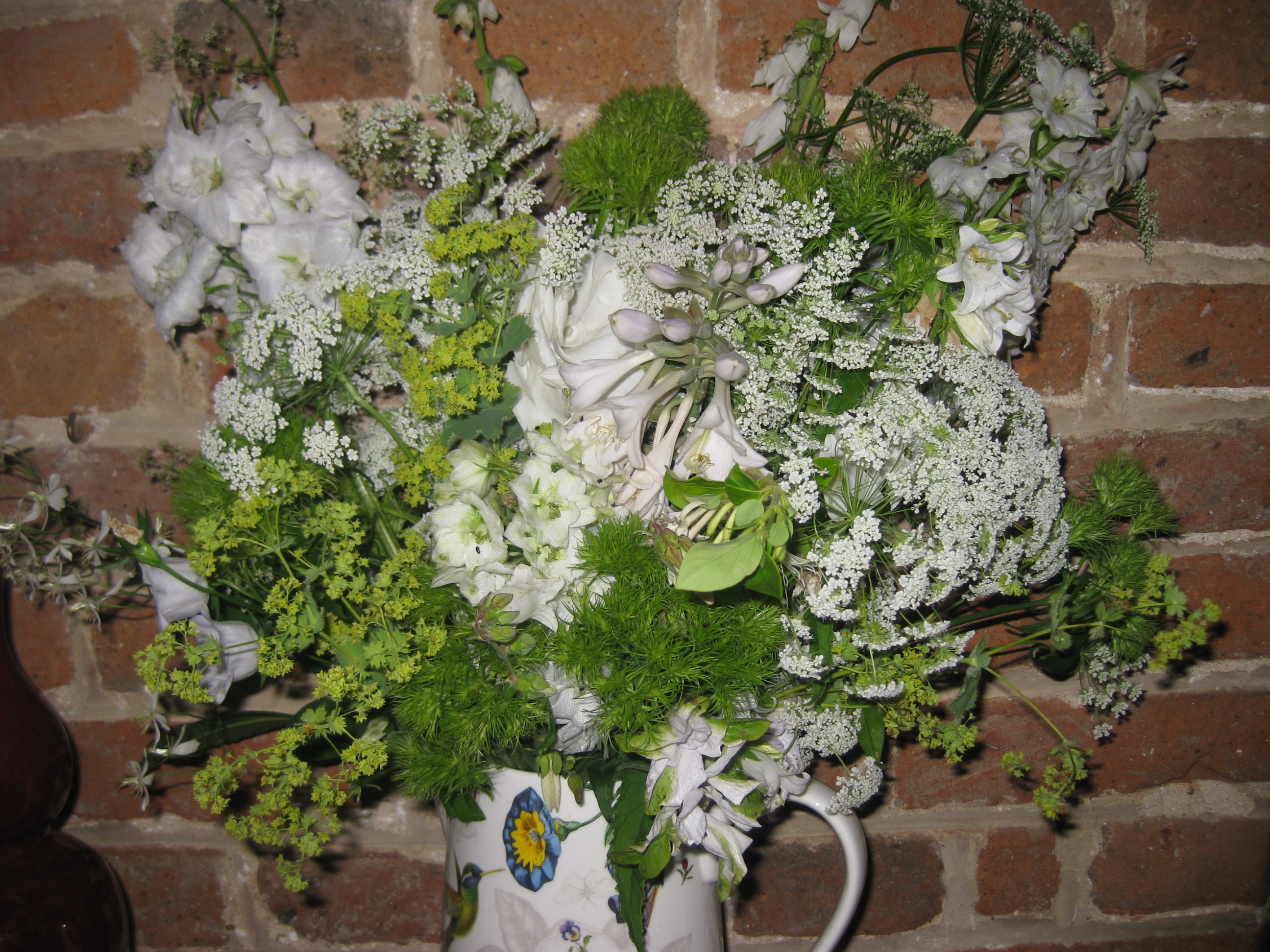 In a vase on monday white foam the blooming garden cathy at ramblinginthegarden has got everyone picking their flowers and putting them in vases do join in it is fun if you go over there you will see what mightylinksfo