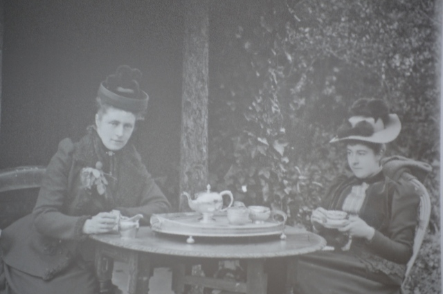 Ellen and her sister Rose having tea in the gazebo